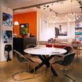 Стол и стулья Minotti, лампа Kartell